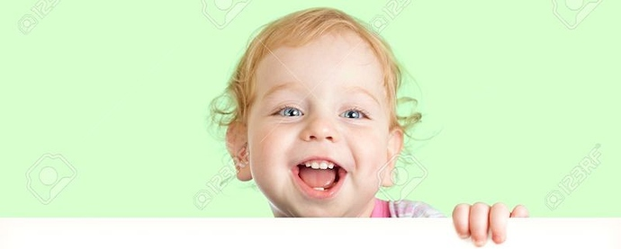 14774465-Happy-child-face-behind-blank-advertising-banner-Banner-and-green-background-are-easily-expandable-i-Stock-Photo